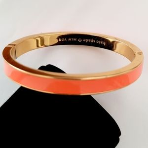 Kate spade coral sparky fly gold tone bangle